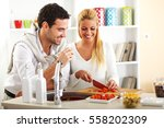 young couple prepare vegetable... | Shutterstock . vector #558202309