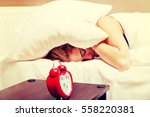 young woman trying to sleep... | Shutterstock . vector #558220381