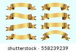 set of golden ribbons on blue... | Shutterstock .eps vector #558239239