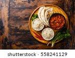 chicken tikka masala spicy... | Shutterstock . vector #558241129