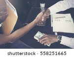 man offering batch of hundred... | Shutterstock . vector #558251665