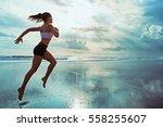 active sporty woman run along... | Shutterstock . vector #558255607