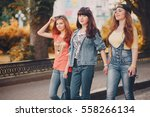 youn girl walking in the park... | Shutterstock . vector #558266134