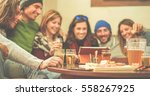happy friends toasting beers... | Shutterstock . vector #558267925