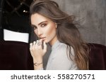 beautiful model with wavy... | Shutterstock . vector #558270571