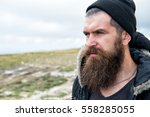 handsome man hipster with beard ... | Shutterstock . vector #558285055
