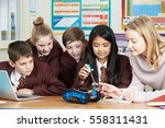pupils and teacher in science... | Shutterstock . vector #558311431