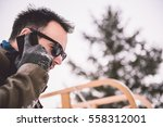man standing by the car and... | Shutterstock . vector #558312001
