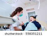 the child in dentist's chair... | Shutterstock . vector #558351211