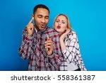 portrait excited joyful couple... | Shutterstock . vector #558361387