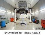 car on a lift in a car repair... | Shutterstock . vector #558373015