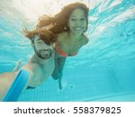 happy couple taking selfie... | Shutterstock . vector #558379825