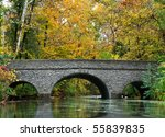 A Stone Bridge Over A River In...
