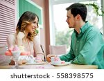 pretty young couple on a date... | Shutterstock . vector #558398575