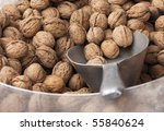 Walnuts on display at a market stall. - stock photo