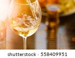 glass of white wine in the... | Shutterstock . vector #558409951