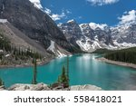 Beautiful panoramic view over Moraine lake in Jasper National Park, Summer Canadian Rockies, Canada. Sunny day with amazing blue sky. Majestic mountains in the background. Clear turquoise blue water.
