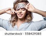 young woman in mask sleeping in ...   Shutterstock . vector #558429385