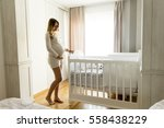 wiew at pregnant woman setting... | Shutterstock . vector #558438229