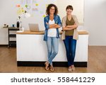 two happy businesswoman working ... | Shutterstock . vector #558441229