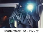 masked burglar with torch and... | Shutterstock . vector #558447979