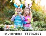 kids on easter egg hunt in... | Shutterstock . vector #558463831