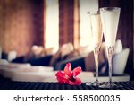 two glasses of champagne with... | Shutterstock . vector #558500035