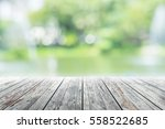 empty wooden table with party... | Shutterstock . vector #558522685