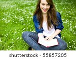 Young Woman Sitting With Book...