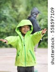 the boy wear green raincoat ...   Shutterstock . vector #558597109