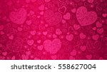 Stock vector background of big and small hearts with swirls in pink colors 558627004