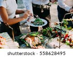 the waiter puts on the plate... | Shutterstock . vector #558628495