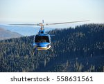 helicopter flying above forest  ... | Shutterstock . vector #558631561