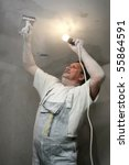 Man plastering wall with work tools - stock photo