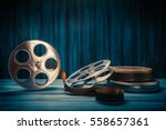 35 mm film reels and cans with... | Shutterstock . vector #558657361