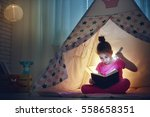 cute little child is reading a... | Shutterstock . vector #558658351