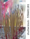 Small photo of incense sticks which are sticking for praying buddha