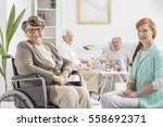 senior on a wheelchair with... | Shutterstock . vector #558692371