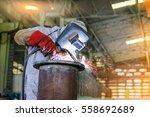 worker welder man welding steel ... | Shutterstock . vector #558692689