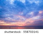 over water setting sun  | Shutterstock . vector #558703141