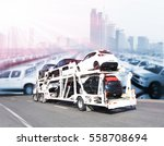 The trailer transports cars on highway with big city background - stock photo