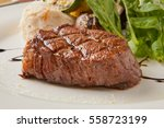 tenderloin steak on plate | Shutterstock . vector #558723199