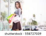 woman holding many shopping... | Shutterstock . vector #558727039