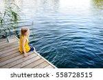 cute little girl sitting on a... | Shutterstock . vector #558728515