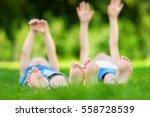 two childrens feet on grass... | Shutterstock . vector #558728539