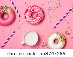 Donuts With Icing And Milk On...