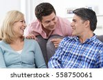 family with adult son at home | Shutterstock . vector #558750061