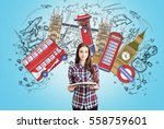 smiling bookworm girl with a... | Shutterstock . vector #558759601