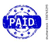 rubber stamp with the word paid ... | Shutterstock .eps vector #558765295