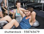 trainer woman helping man doing ... | Shutterstock . vector #558765679